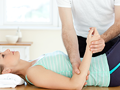 Physiotherapist Checking a Woman's Hand