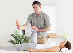 Physiotherapist Checking Woman's Leg Movement